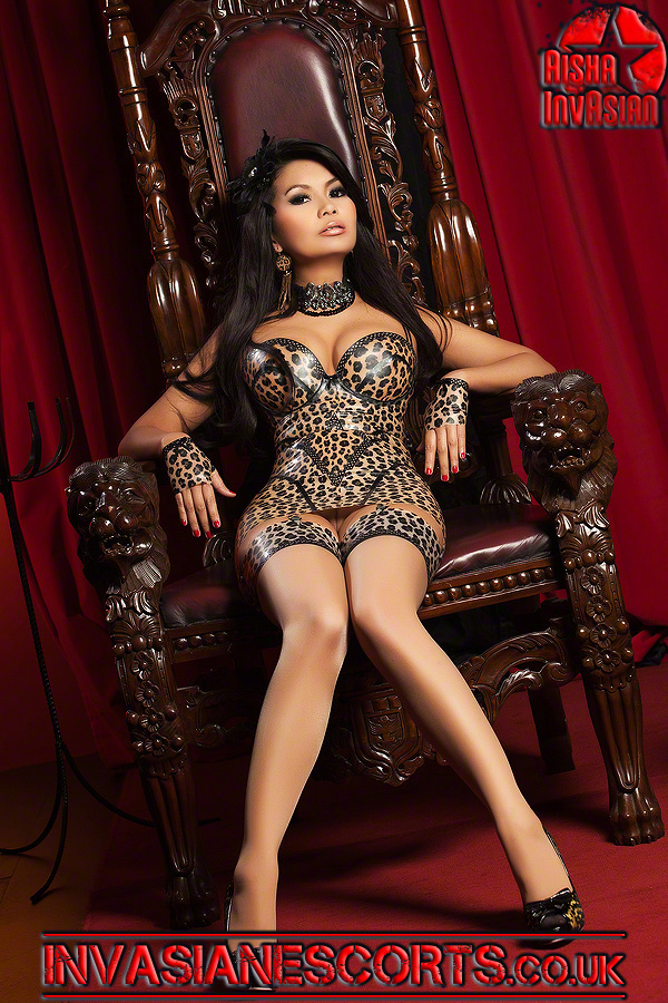 Raunchy escort Reiya in leopard print PVC dress 1